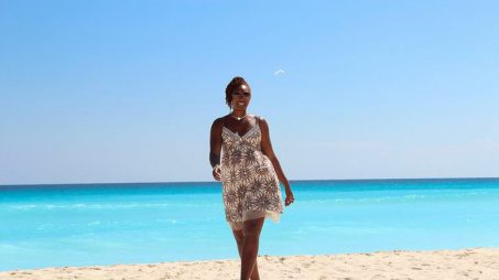 Tracy-walking-on-the-beach-in-cancun.jpg