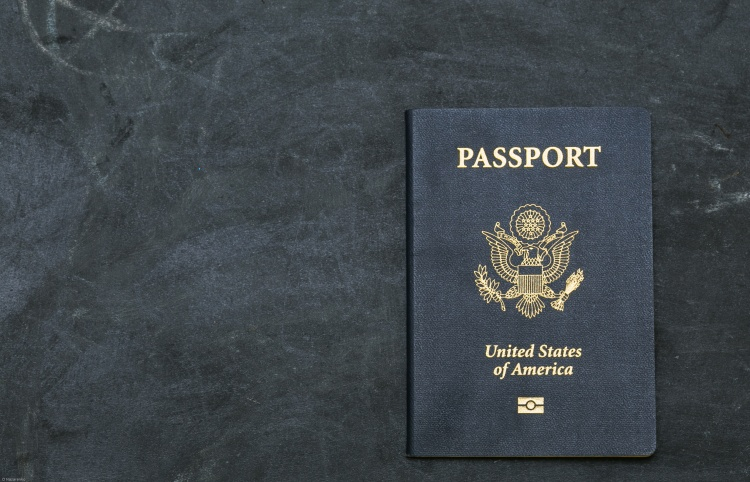 US passport on black background